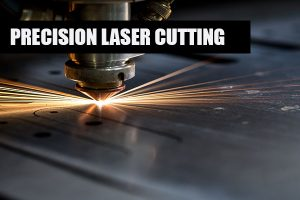 Cutting of metal. Sparks fly from laser, close-up